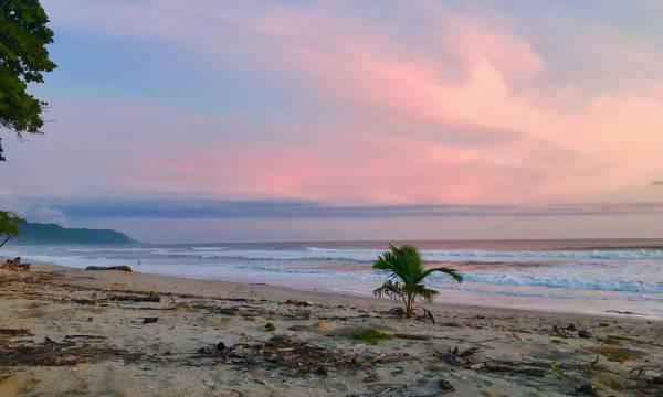 Psetel colors sunset on Santa Teresa beach in Costa Rica